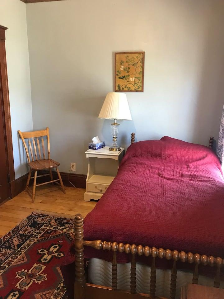 Yellow stucco single bedroom