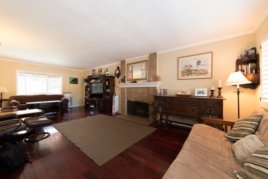 """Living room with Sofa & Futon, 60"""" TV, mini Air Hockey table and entertainment system"""