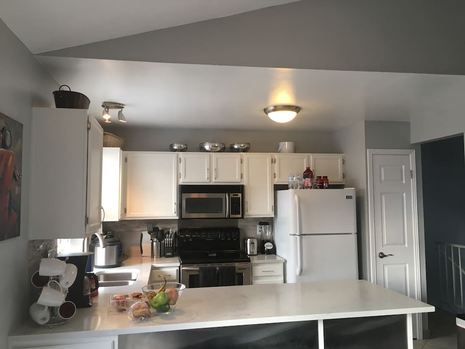 Spacious fully equipped kitchen, fridge, and pantry full of condiments, coffee, spices, basic necessities for your use.