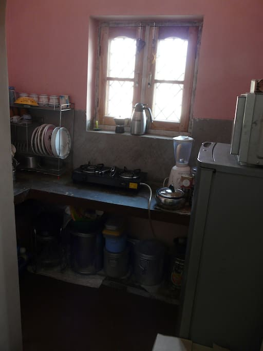 Kitchen with fridge, gas stove, microwave combi.