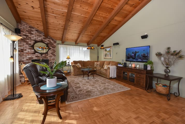 The living room offers plenty of cozy seating and is equipped with a TV that can stream Netflix or play DVDs.