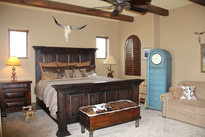 Texas suite with king bed and queen sofa bed, private bath, pool deck access.