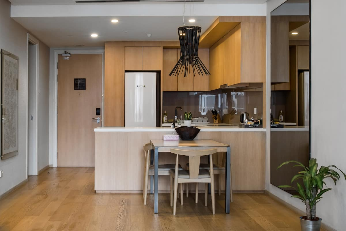 Walk to Twin Towers from a Chic and Modern Condo with a View