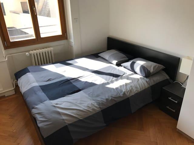 Lovely bedroom in riverside apartment