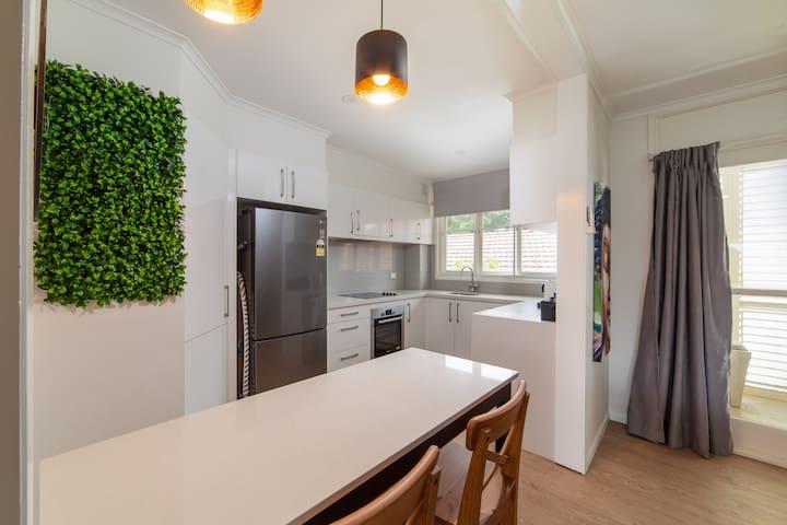 Kitchen area with fridge, stove & oven and dishwasher