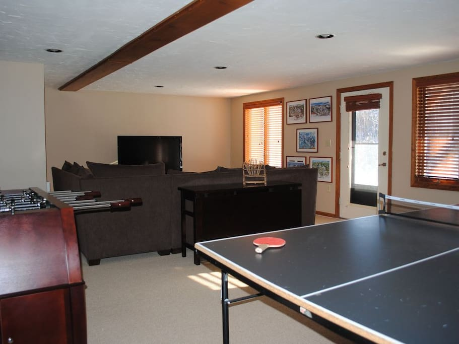 Fully equipped game room/entertainment center in basement.