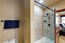 The master bathroom is configured with a walk-in shower.