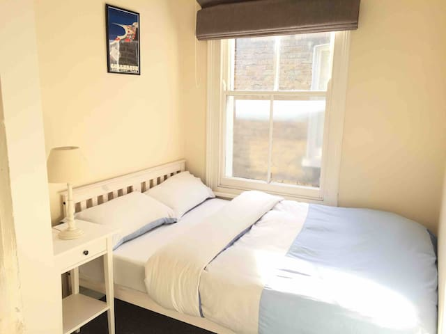 Clean, comfortable double bed in London townhouse