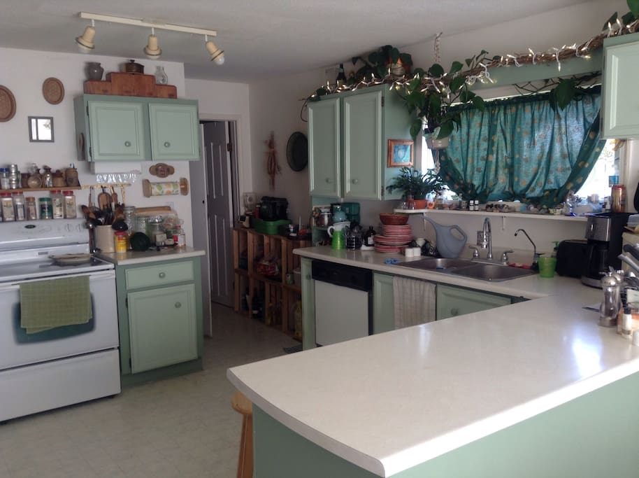 Kitchen is clean with new fridge & stove
