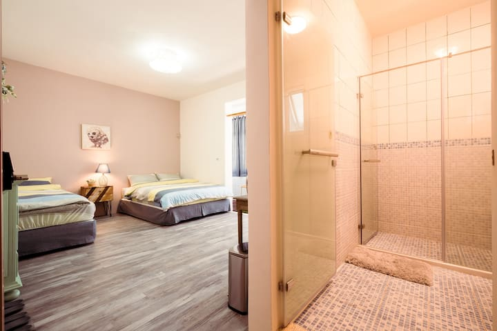 Private room with own bathroom(one double bed + one single bed).