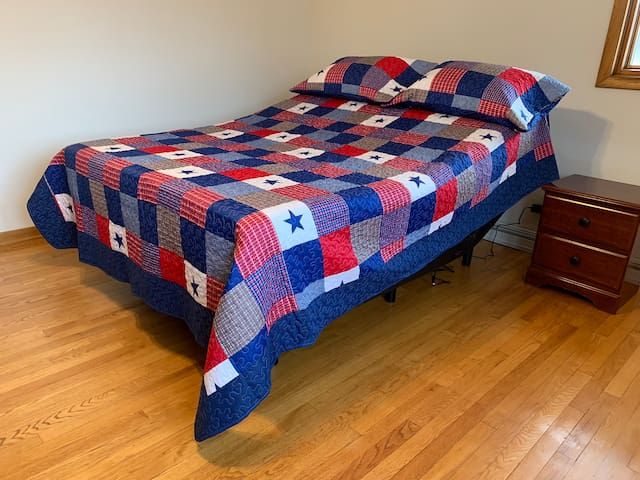 Master bedroom with fully adjustable  Bedframe and queen size memory foam mattress