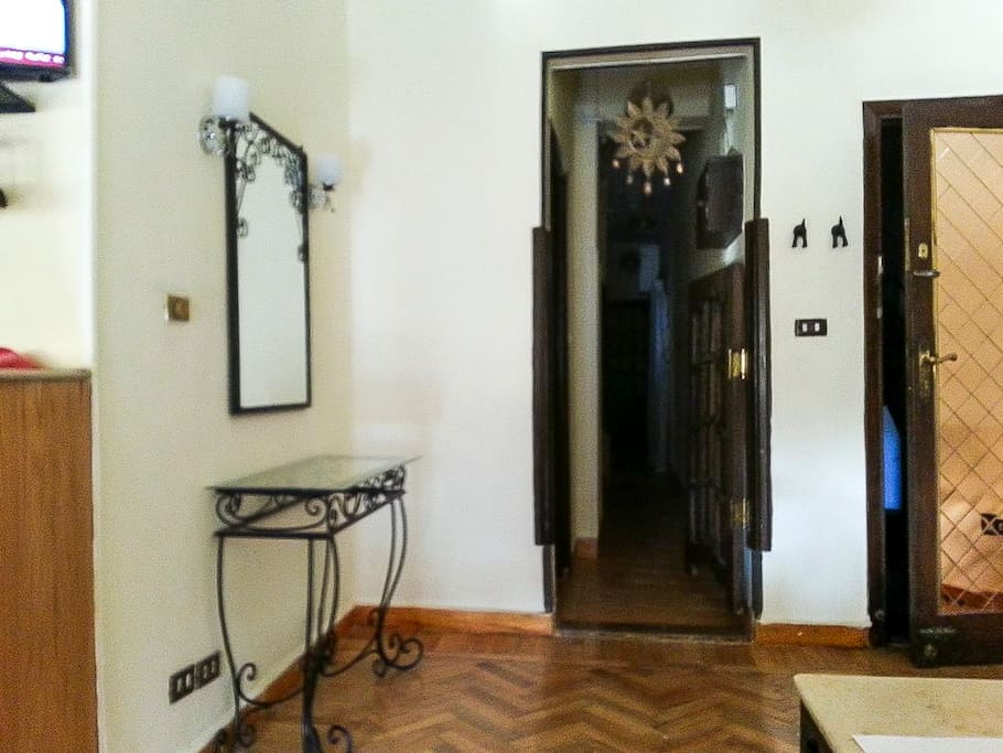The hall next to the door leading to the three bedrooms and bathroom.