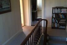 Hallway leading to the Acadia Room ( Bedroom 1) and Bathroom