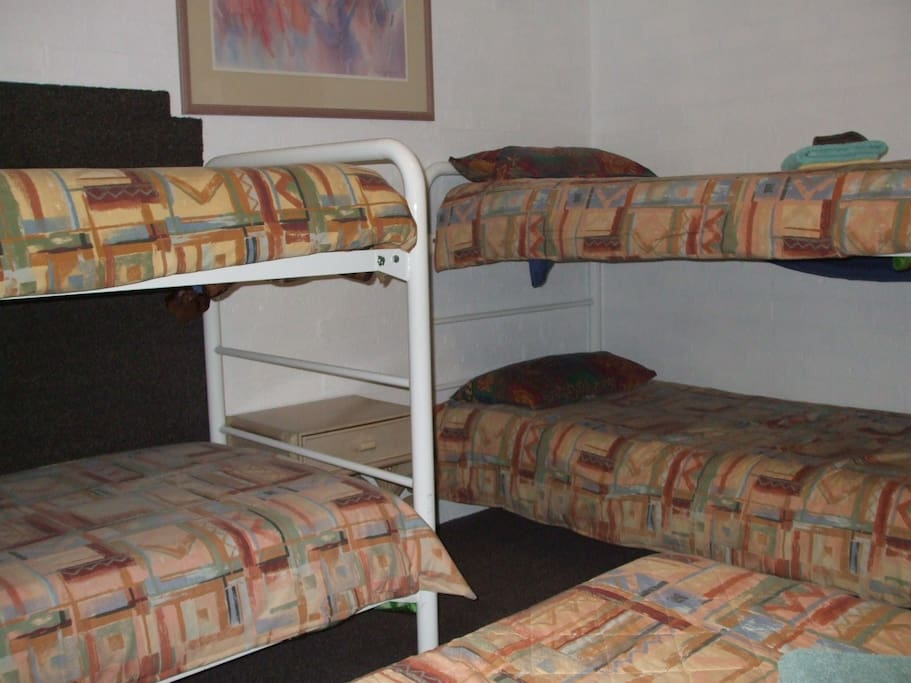 Double bed and four single bunk beds