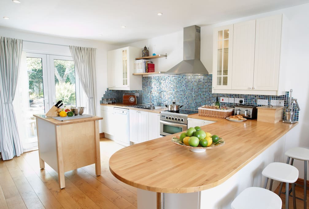 Ground floor:  Open plan kitchen with dining area seating eight guests