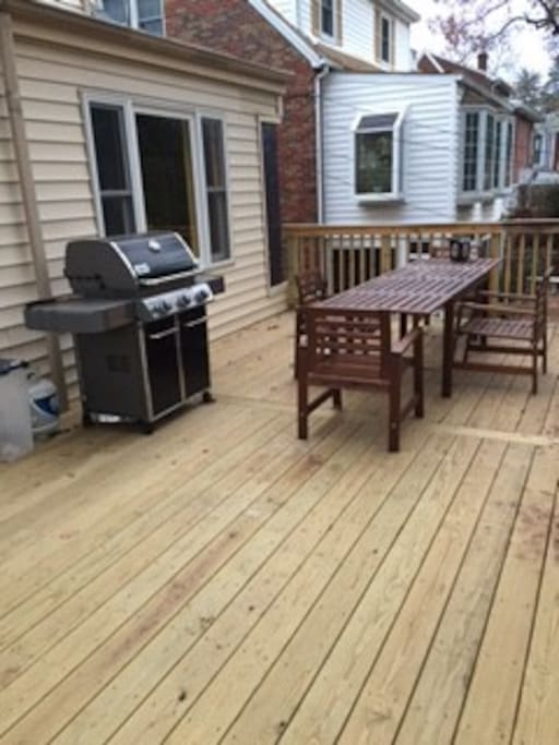 Amazing large deck with Weber barbeque.