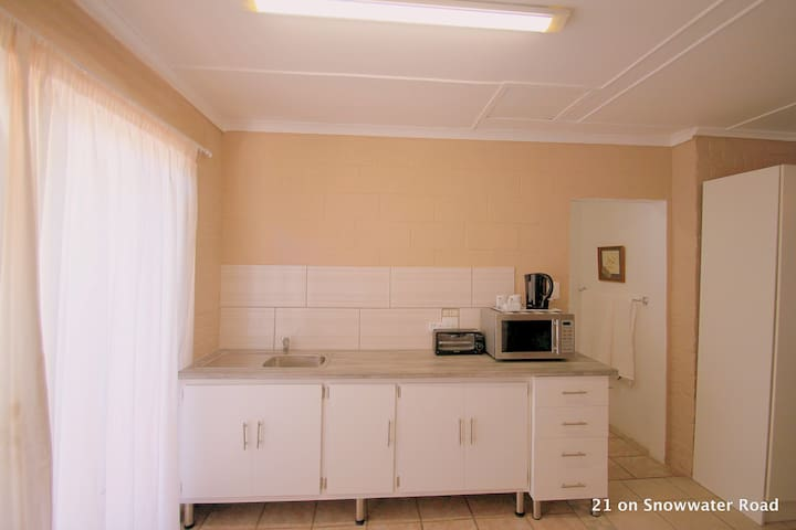 fully furnished kitchen with small stove/oven.