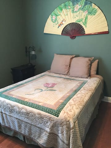 Spacious bedroom and comfortable queen sized bed.