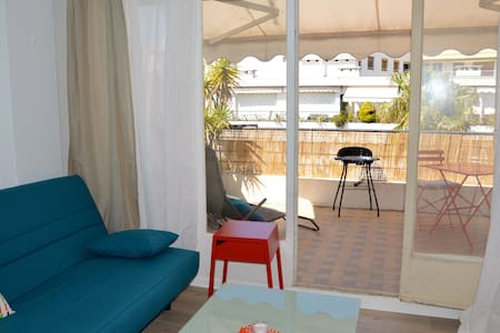 Sweet place 50m from the sea with great patio