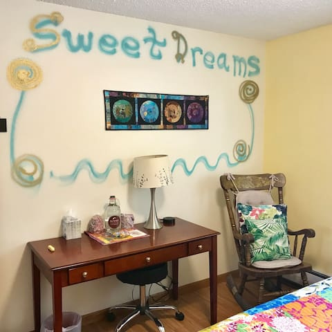 Water, glasses, treats, desk, usb plug ins, rocking chair. Sweet Dreams!