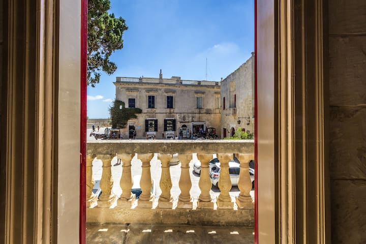The drawing room/Sala Nobile overlooks the Bastion Square - one of Mdina's most picturesque spots.  People watch, enjoy your morning coffee, your evening glass of wine.... the possibilities are endless.