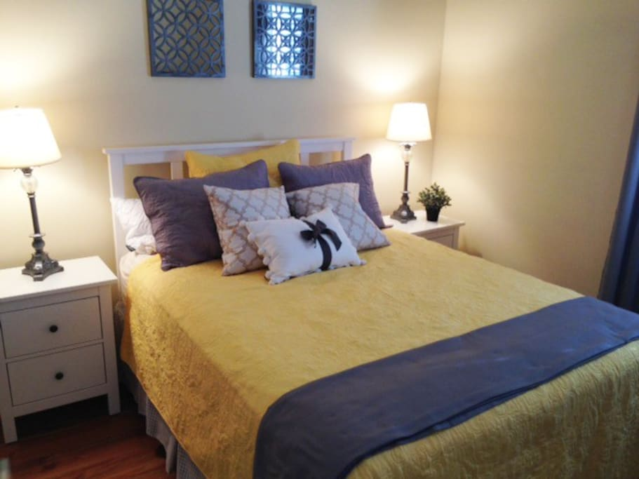 One of two Queen beds in 2BR apartment of compound.