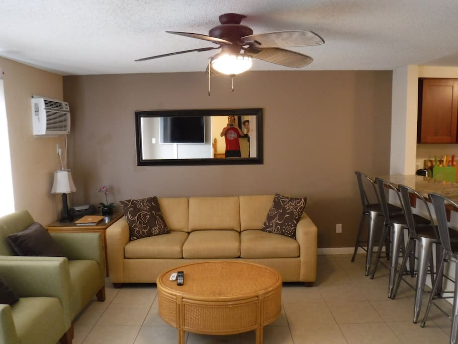 Living room with AC and ceiling fan