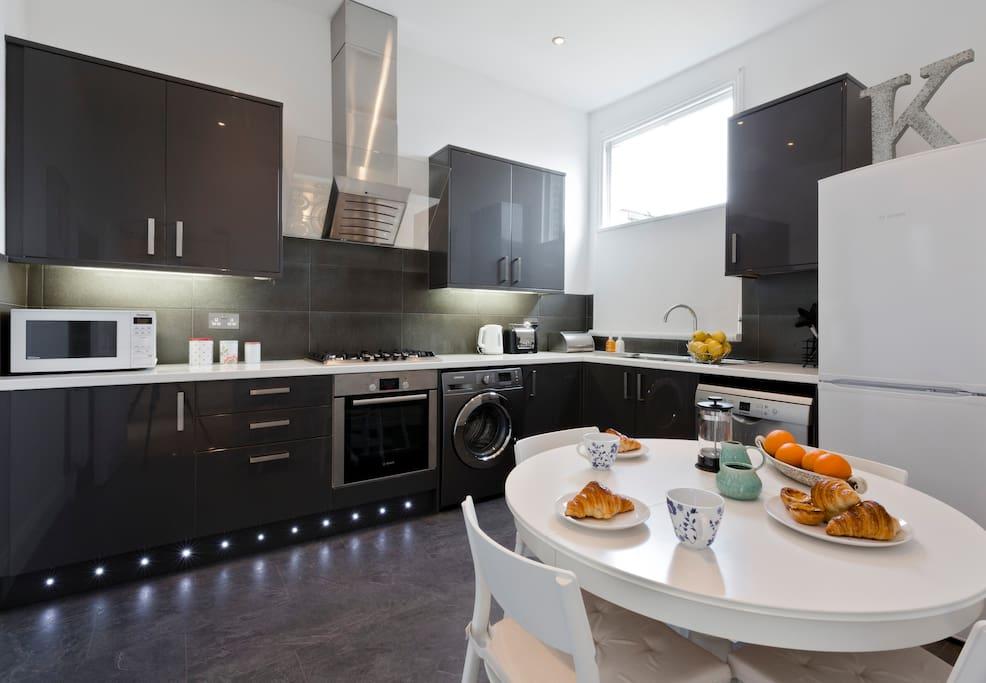 Kitchen with oven, gas hob, fridge freezer, microwave, washing machine, dishwasher