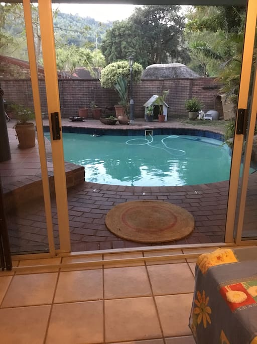 It opens up to the pool and garden.