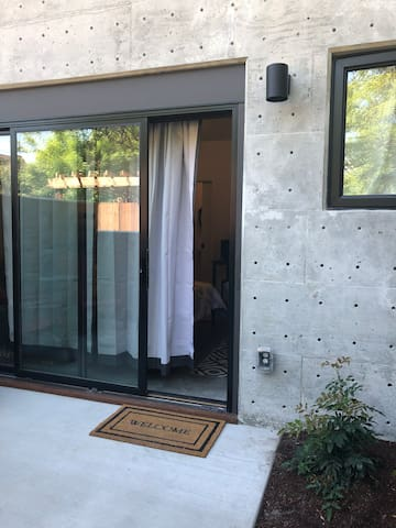 The sliding glass door has a key that is stored in a combination lock on the fence.