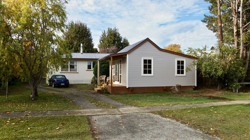 Here's your cottage, just in front of our house, and next to the footpath. Nice to have your own self contained place with easy access to the street.