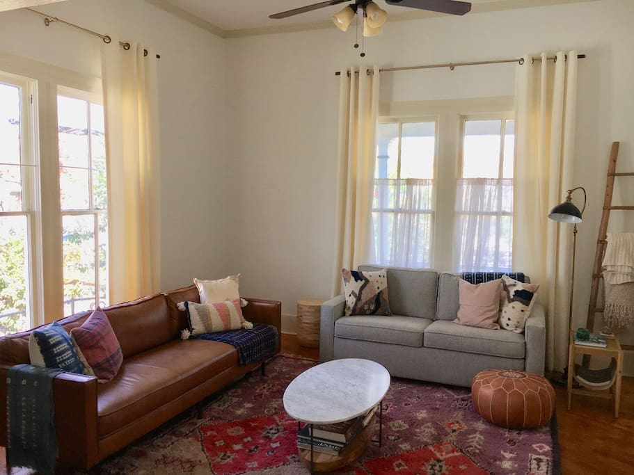 Cozy living room with 11.5 ft ceilings and original wood floors.