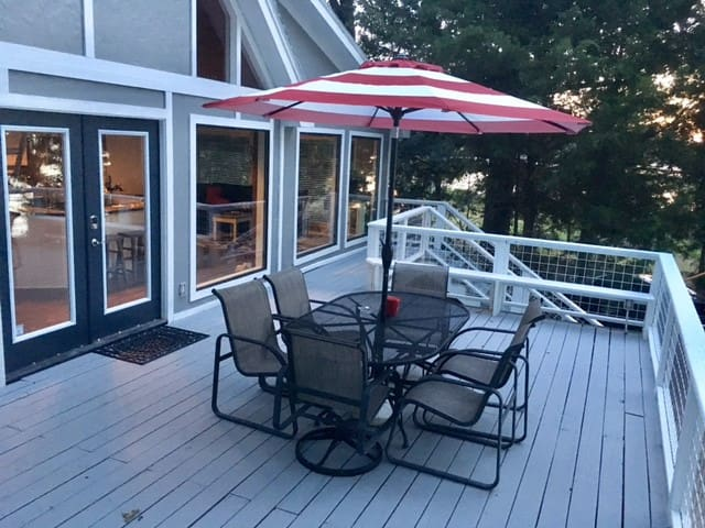 Take in the sunset from the large deck with patio table and grill.