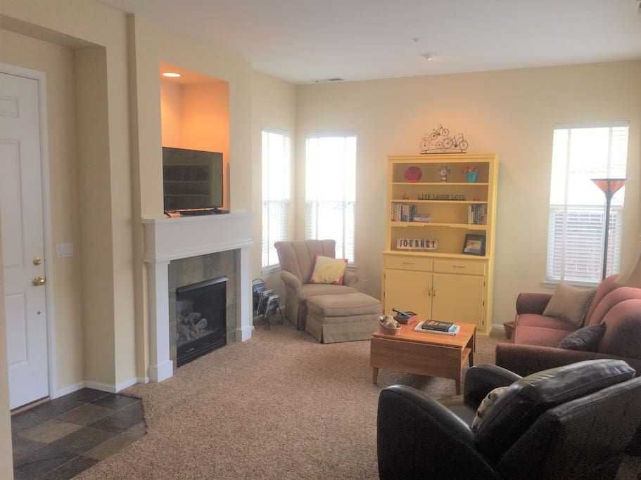 "43"" inch TV, gas fireplace, games & DVDs in hutch"