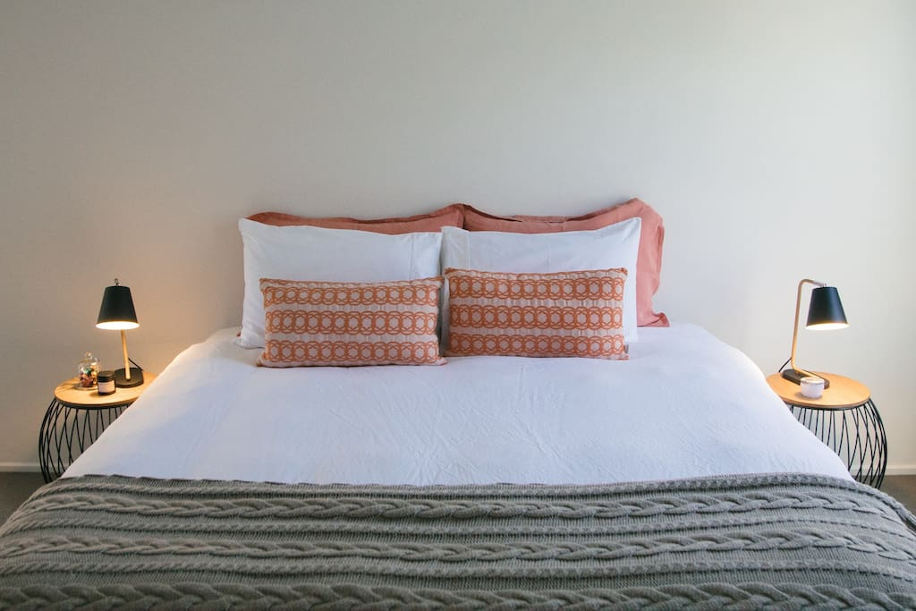 King size bed with crisp white cotton sheets & French Flax duvet cover
