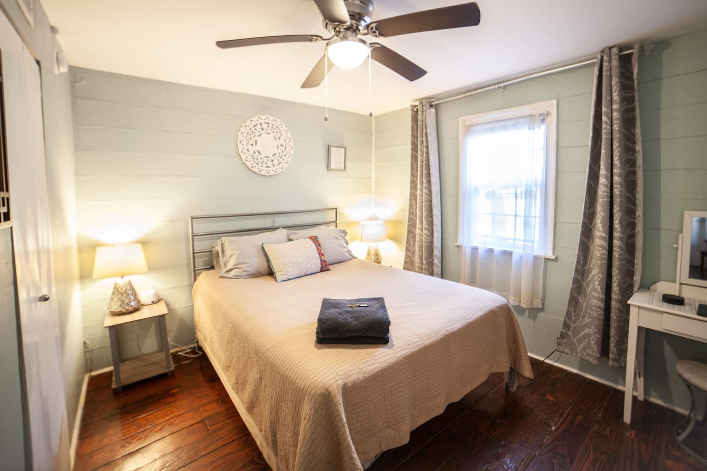 The Brazil Room has a queen bed with a desk, chair, closet and en suite bathroom.