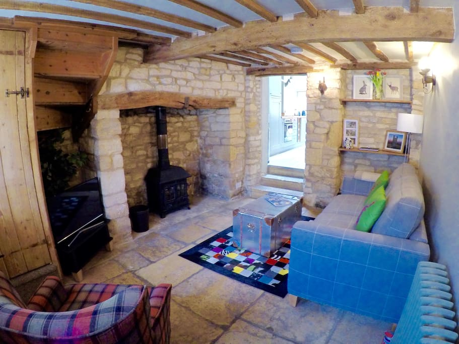 The welcoming front room with hearth and log burning stove.