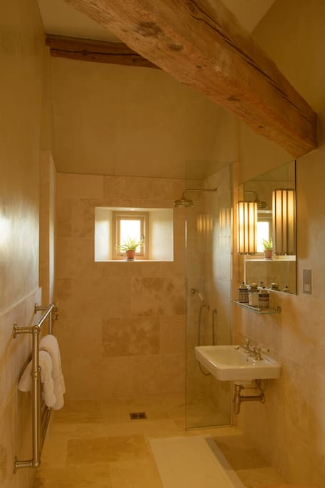 Italian Room's en suite shower room, accessible for wheel chair users as well.