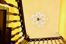Interiors of Swafield Hall. 18th century main staircase with a large crystal chandelier.