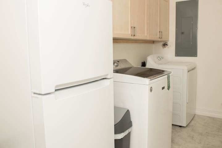Laundry area with extra fridge