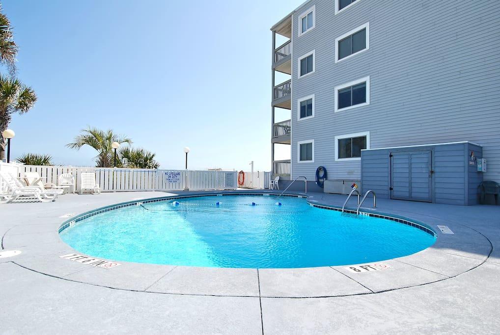 Splash around in the outdoor swimming pool