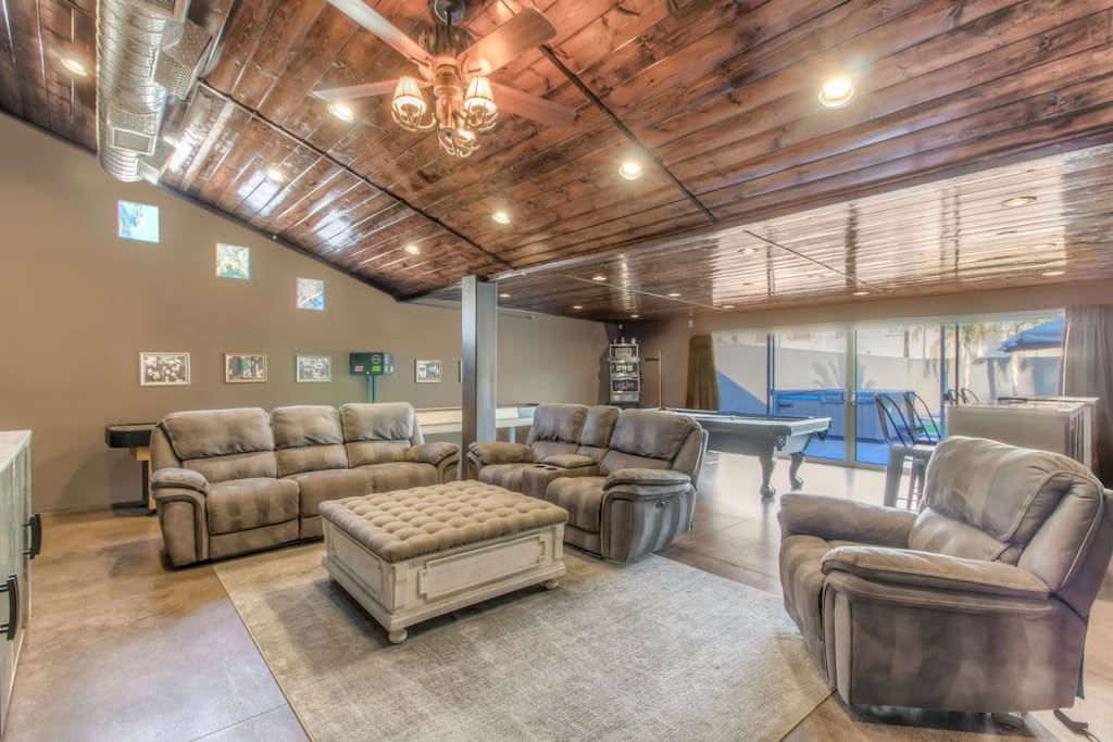 Large seating area in the man den with 2 big screen TV's, shuffleboard table, and 8' pool table!