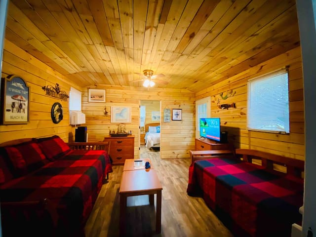 One-of-a-Kind Clean and Fresh Country Cabin Offers near Carolina Beach offers 4 separate rooms: Queen Bedroom with desk and furnishings, Cozy Bathroom, Large Living Room with 2 twin beds and Large Kitchen/Dining  Room.