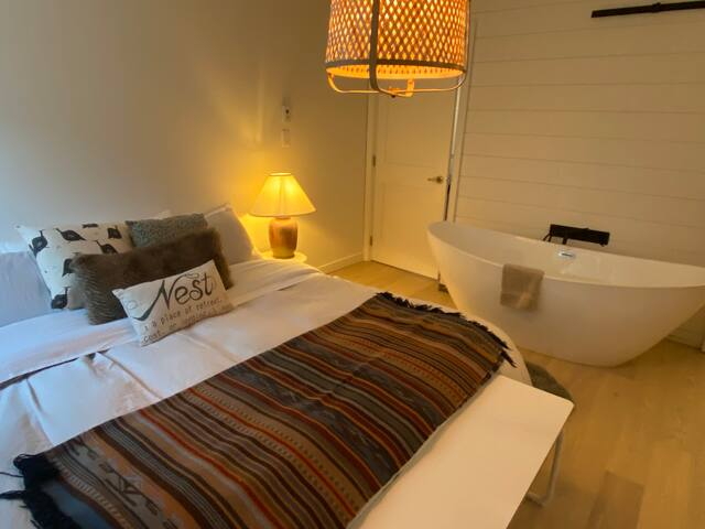 King size bed and 2 person large soaker tub with ensuite bathroom