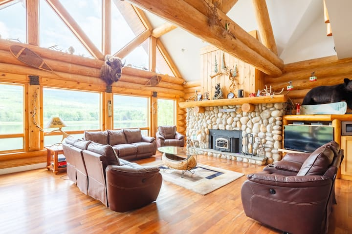 Huge stone fireplace great for family photos, this room is 33 feet wide