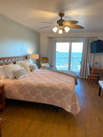 Comfortable king size bed in the primary bedroom overlooking the Gulf of Mexico