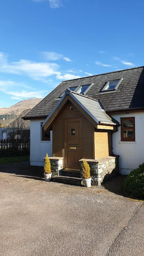Modern cosy cottage in West Highland Village