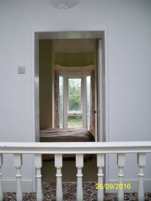 The single room looks out towards the front of the house