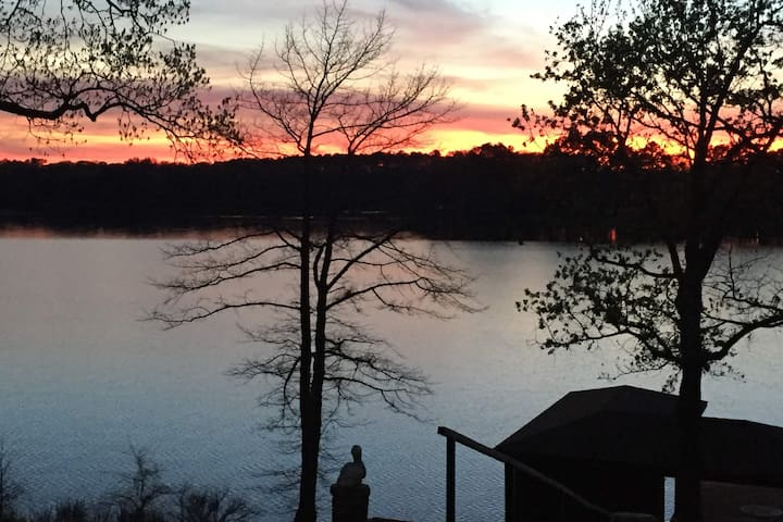 Enjoy sunsets like this from the rocking chairs on the front porch or while relaxing on the dock.