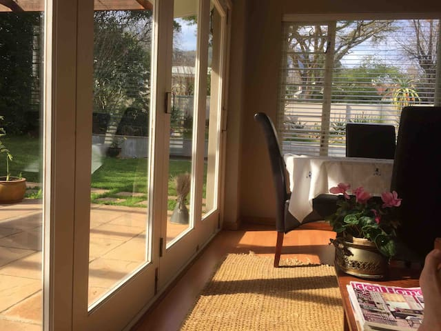 Sunny lounge, with stacker doors opening into the garden
